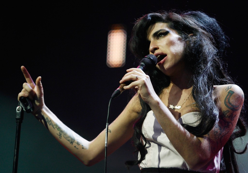 LONDON - SEPTEMBER 19: Singer Amy Winehouse performs at the Music of Black Origin Awards (MOBO) at the O2 Arena Greenwich on September 19, 2007 in London, England. (Photo by Jo Hale/Getty Images)