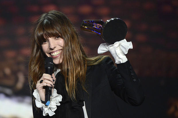 French singer Lou Doillon holds her trophy after receiving the women's artist of the year award during the 28th Victoires de la Musique, the annual French music awards ceremony, on February 8, 2013 at the Zenith concert hall in Paris. AFP PHOTO / BERTRAND GUAY (Photo credit should read BERTRAND GUAY/AFP/Getty Images)